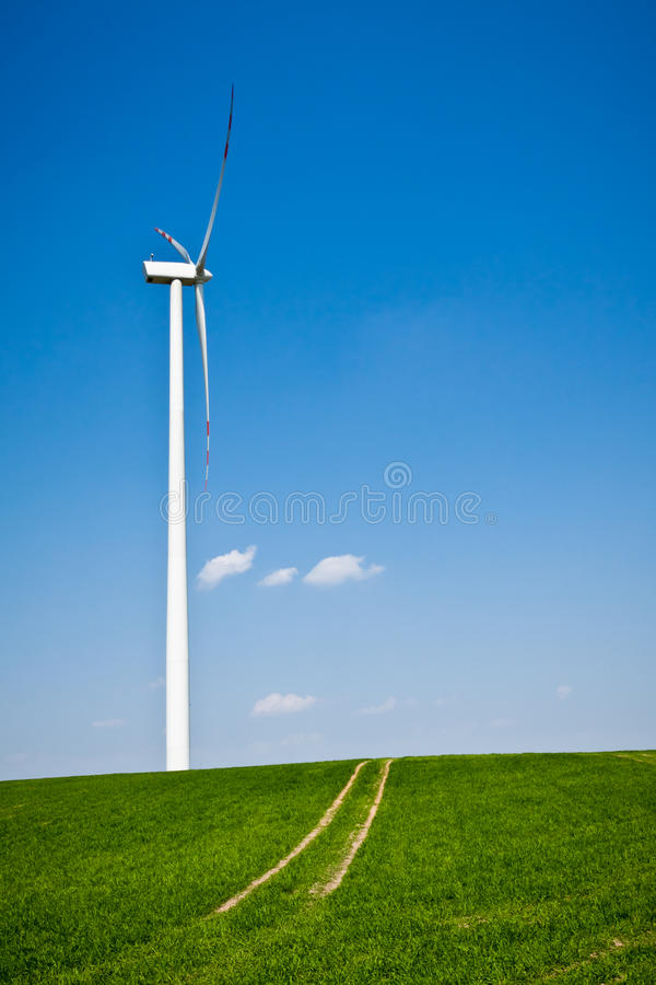 Wind Turbine with path on green field stock photos
