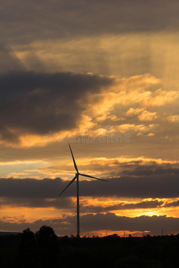 Download Wind Turbine Power Generator At Sunset Stock Photo - Image: 83706669