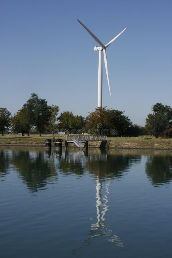 Wind Turbine on the Rhone banks stock photography