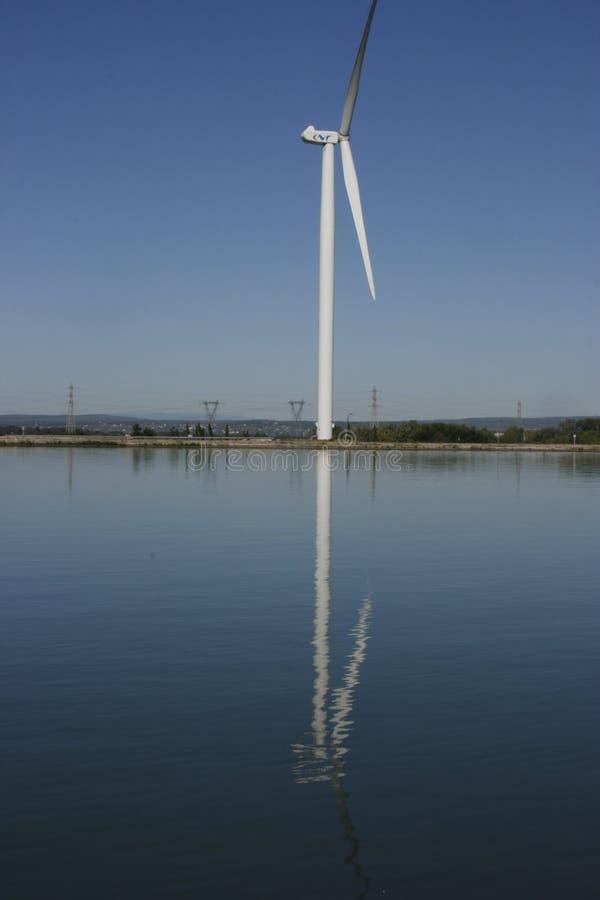 Wind Turbine on the Rhone banks royalty free stock photos