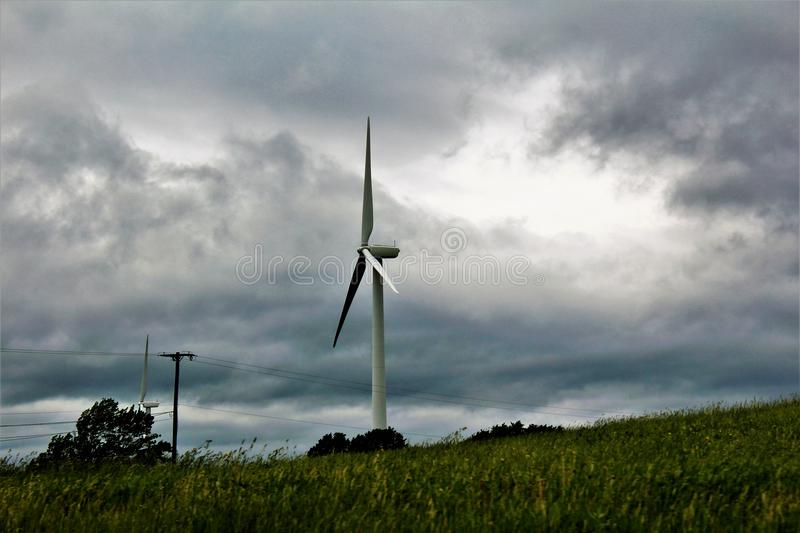 Wind Turbine in Chateaugay, Franklin County, in upstate New York, United States. Wind Turbine in a rural country grass field located in Chateaugay, Franklin royalty free stock photography
