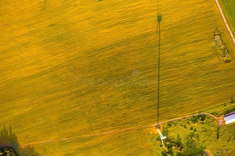 Wind turbine shadow on farmland, aerial landscape. Renewable energy concept stock photo