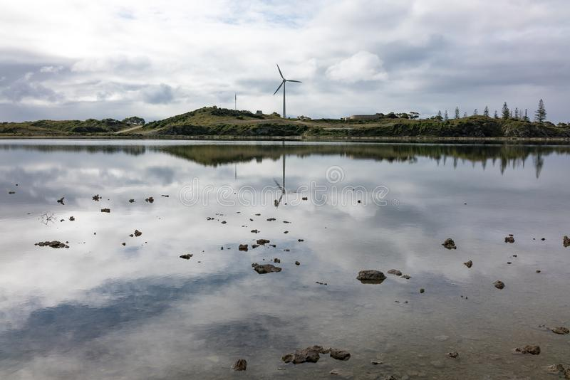 Reflections of a wind turbine stock photos