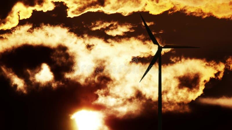 Wind Turbine at sunrise stock photo