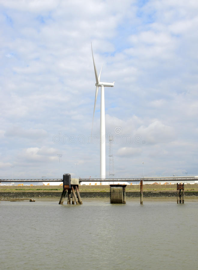 Wind turbine on the thames royalty free stock images