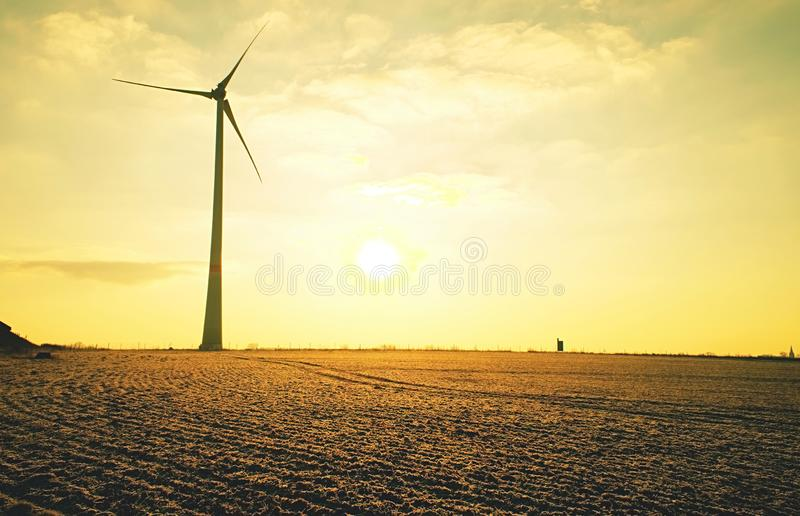 Wind turbine or windmill for clean green energy concept royalty free stock photo