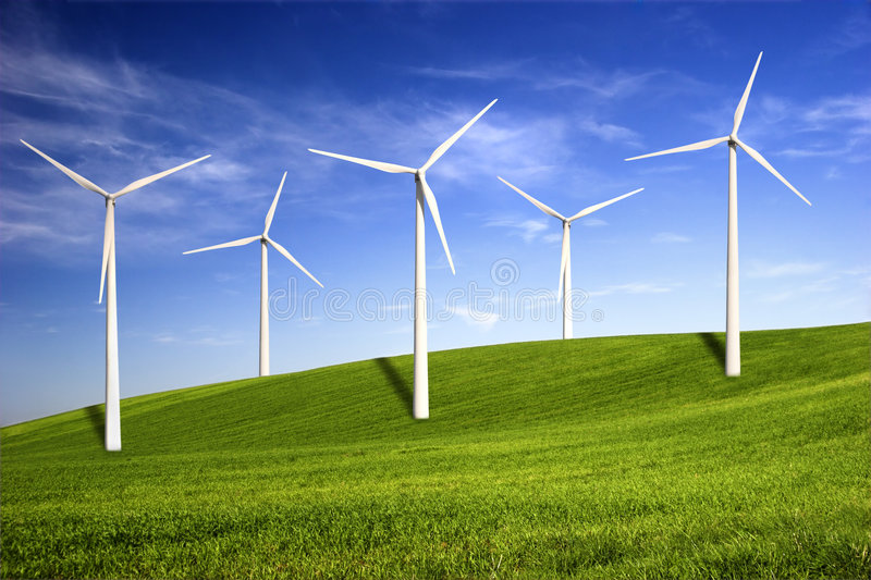 Wind turbines. Beautiful green meadow with Wind turbines generating electricity