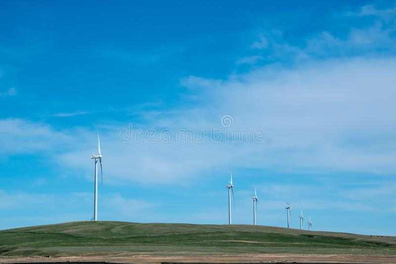 Wind Turbines against prairie fields and big blue skies. stock photo