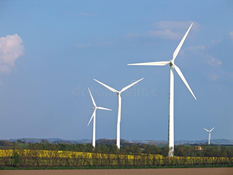 Wind turbines - Alternative energy. Environmental friendly alternative energy by wind turbines stock photos