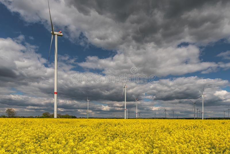 Wind turbines alternative energy sources produce green energy. Contrast of technology to agriculture. Concept: energy stock photos