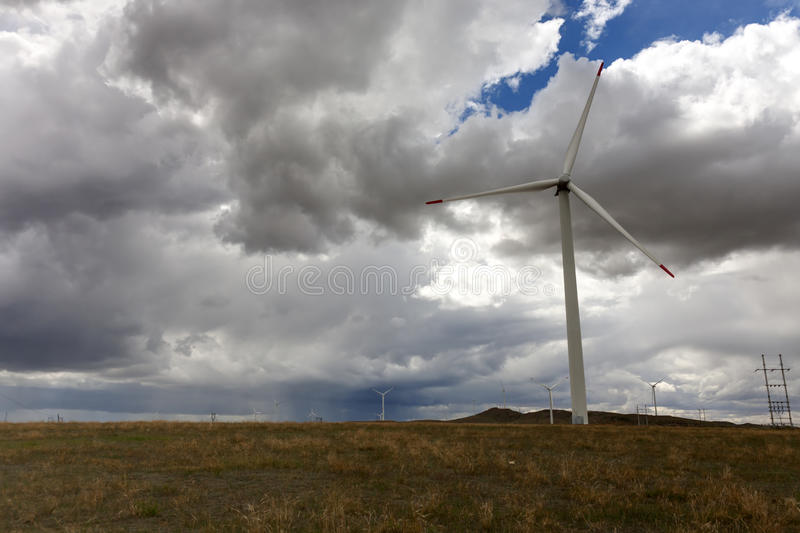 Wind turbines. And cloudy sky stock image