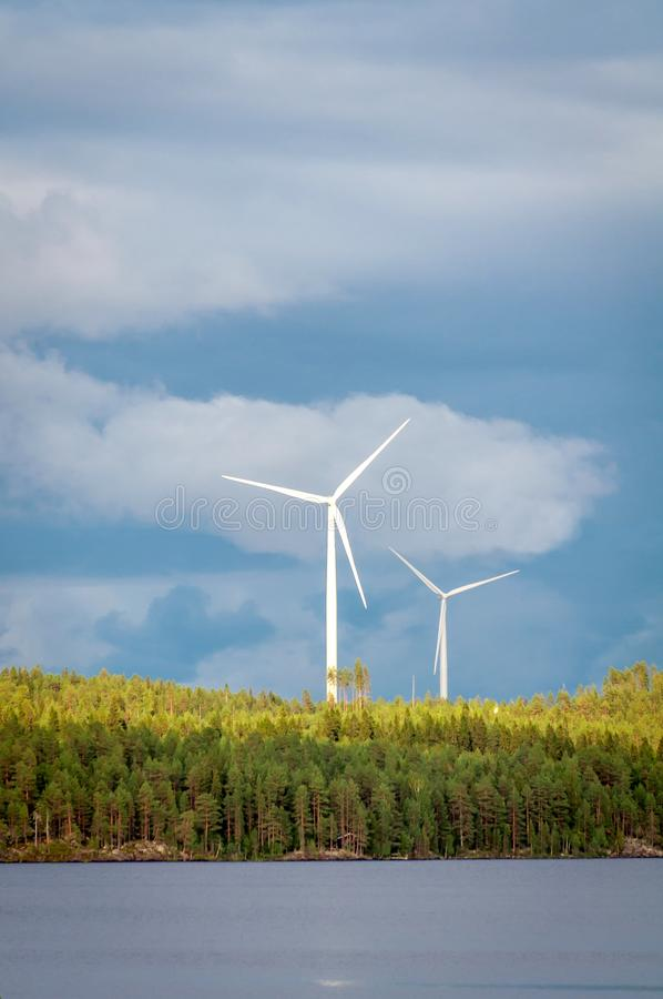 Wind turbines, converting the wind`s kinetic energy into electrical energy - ecologically clean source of energy. stock image