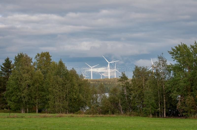 Wind turbines, converting the wind`s kinetic energy into electrical energy - ecologically clean source of energy. royalty free stock photos