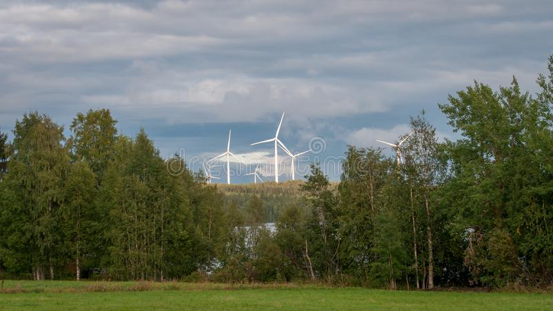 Wind turbines, converting the wind`s kinetic energy into electrical energy - ecologically clean source of energy. stock images