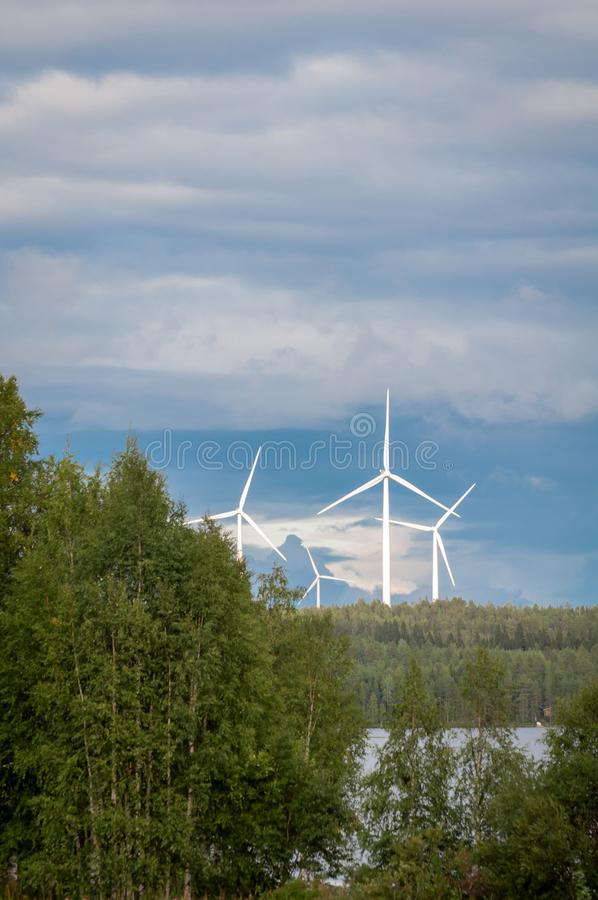 Wind turbines, converting the wind`s kinetic energy into electrical energy - ecologically clean source of energy. stock photos