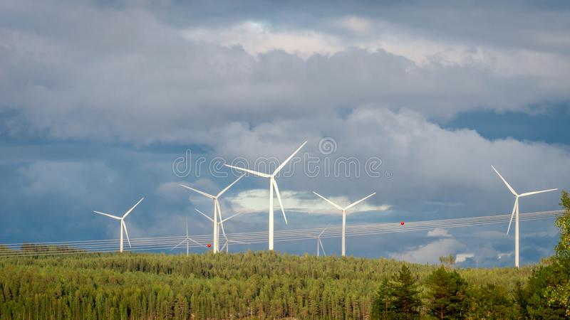Wind turbines, converting the wind`s kinetic energy into electrical energy - ecologically clean source of energy. royalty free stock photo