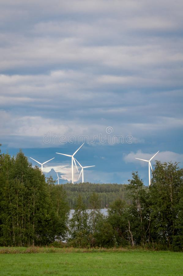 Wind turbines, converting the wind`s kinetic energy into electrical energy - ecologically clean source of energy. royalty free stock image