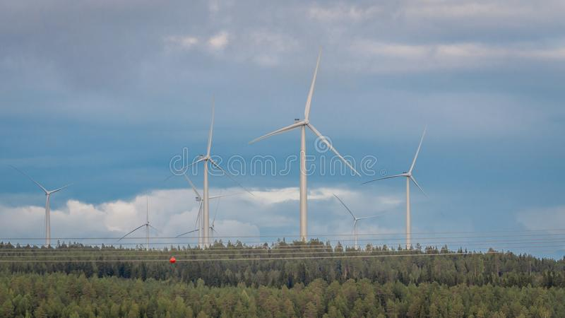 Wind turbines, converting the wind`s kinetic energy into electrical energy - ecologically clean source of energy. royalty free stock images