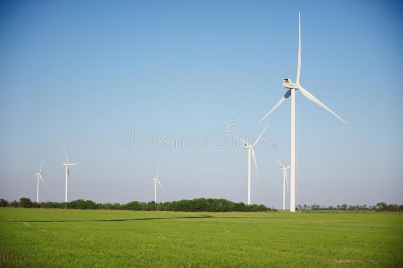 Wind turbines at daytime. Green field with wind turbines at daytime royalty free stock photo