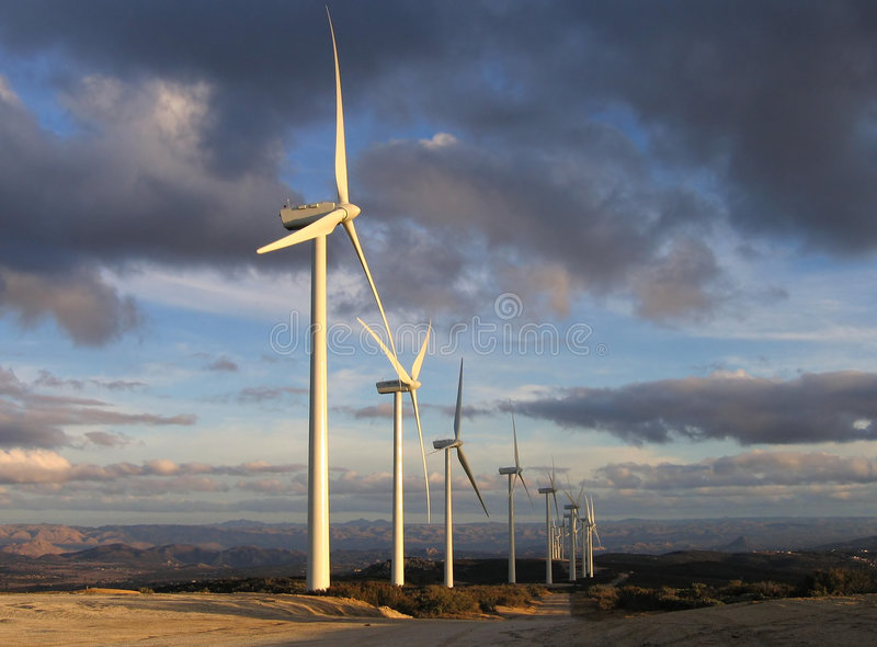 Wind turbines at dusk stock photography