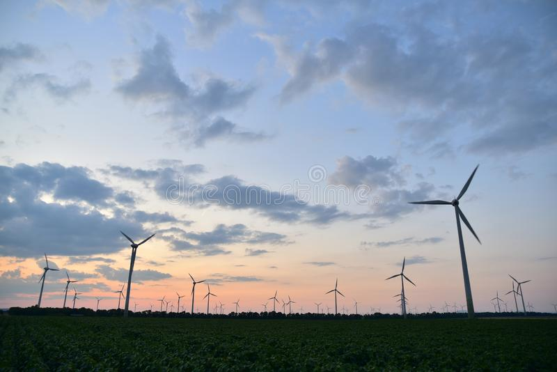 Wind turbines at dusk royalty free stock photo