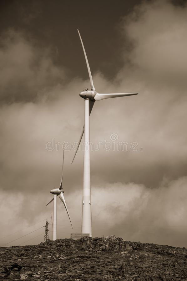 Wind turbines for electric power generation over hills. Wind turbines for electric power generation over hilly landscape, in a sunny day near Sortelha. One of stock photography