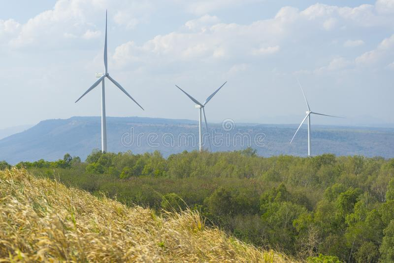 A Wind turbines farm on the hill. Alternative energy source. A Wind turbines farm on the hill. Alternative energy source in Thailand stock photo