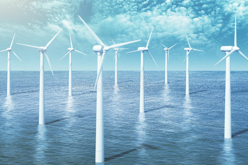 Wind turbines farm in the ocean stock images