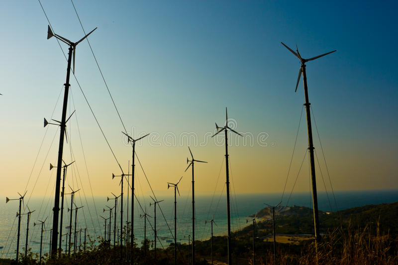 Wind turbines farm with a sunset. Pattaya Thailand stock image