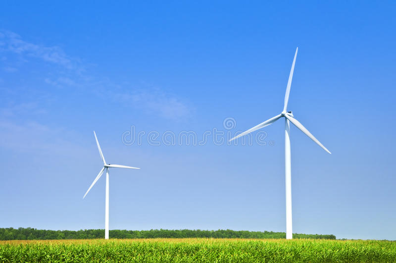Wind turbines in field stock images