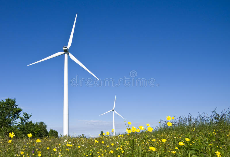 Wind turbines in a field. royalty free stock photos
