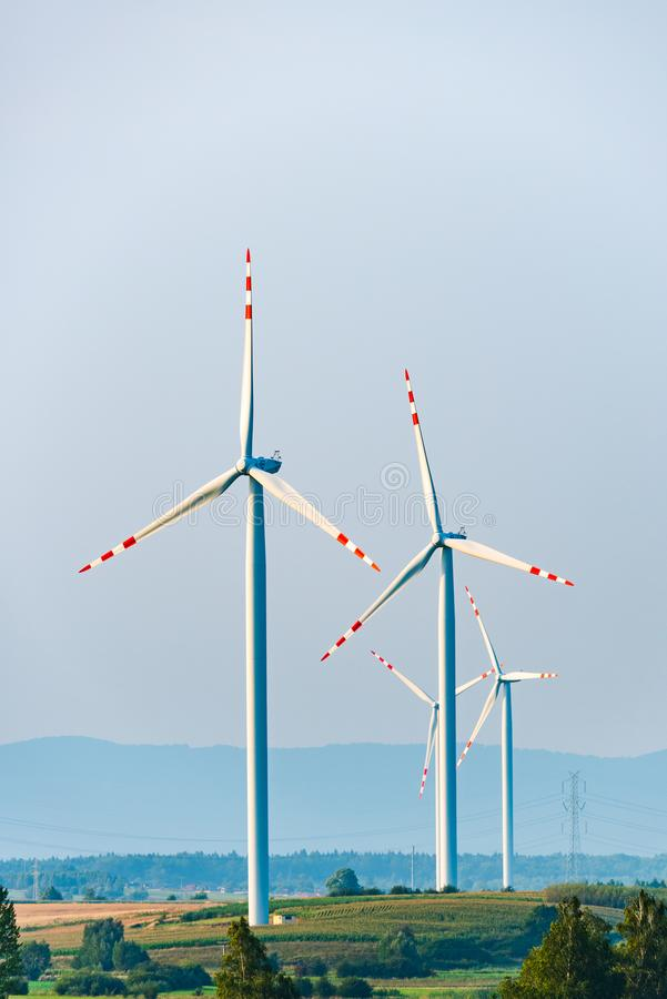 Wind turbines on the field in rural area royalty free stock photography