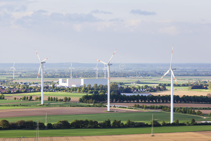 Wind turbines in flat landscape. Flat west German landscape near Aachen and Herzogenrath with wind turbines in the foreground stock photos