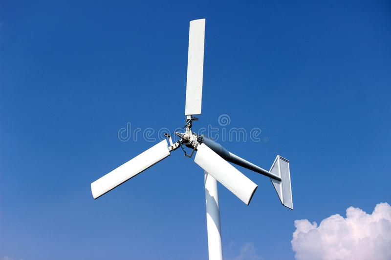 Wind turbines generating electricity with blue sky - energy conservation concep stock photo