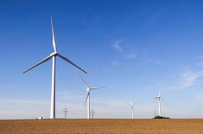 Wind turbines generating electricity with blue sky stock images