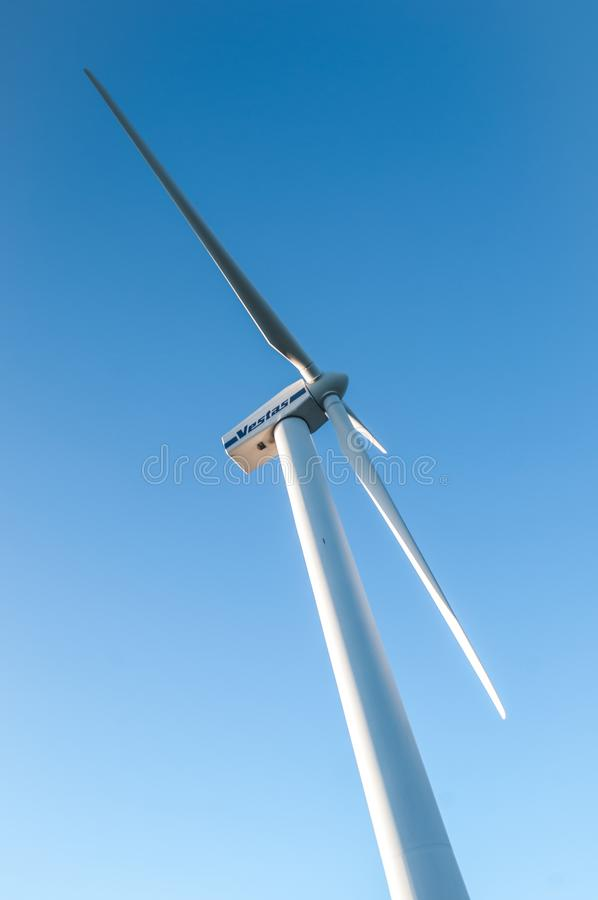 Wind turbines generating electricity with blue sky royalty free stock photo
