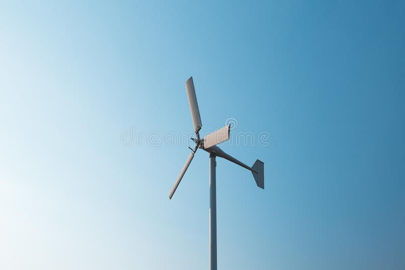 Wind turbines generating electricity with blue sky. Energy conservation concept royalty free stock image