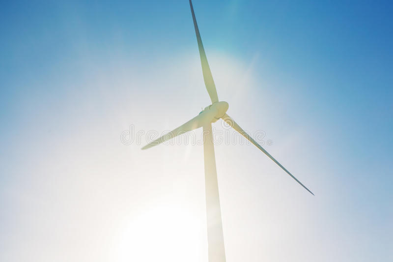 Wind turbines generating electricity with blue sky - energy conservation concept royalty free stock photos