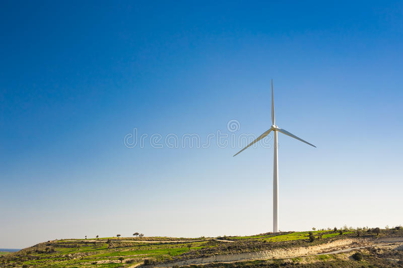 Wind turbines generating electricity with blue sky - energy conservation concept royalty free stock images
