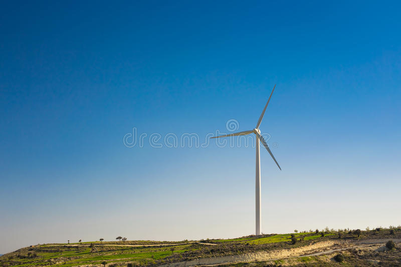 Wind turbines generating electricity with blue sky - energy conservation concept stock images