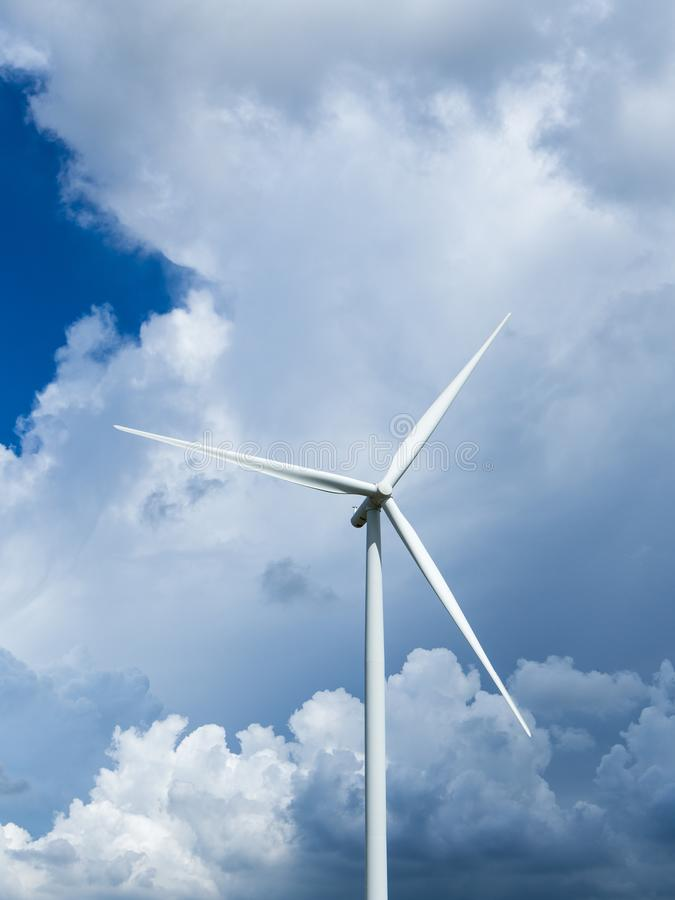 Wind turbines generating electricity with blue sky. Windmills for electric power production stock image
