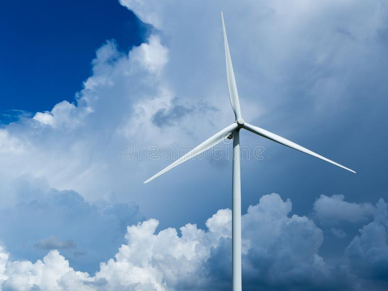 Wind turbines generating electricity with blue sky. Windmills for electric power production stock photography