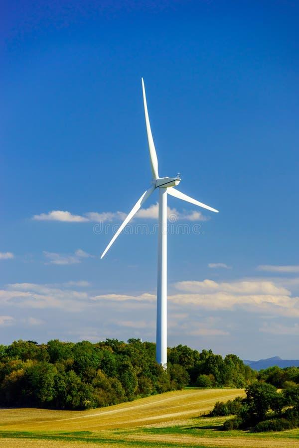 Wind turbines generating electricity in windfarm. Loraine, France stock photo