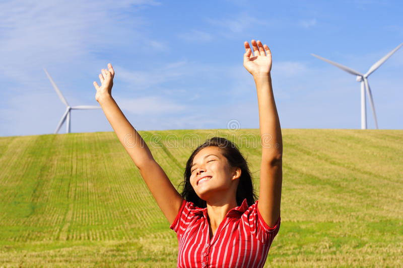 Wind turbines and happy woman royalty free stock photo