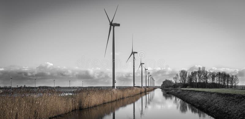 Wind turbines harvesting energy in Holland stock photos