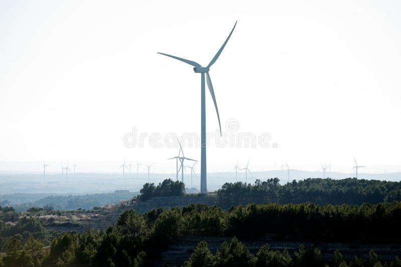 Wind turbines on hilltops, Catalonia, Spain royalty free stock photo