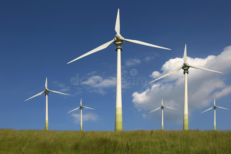 Wind turbines on a meadow green energy stock photo