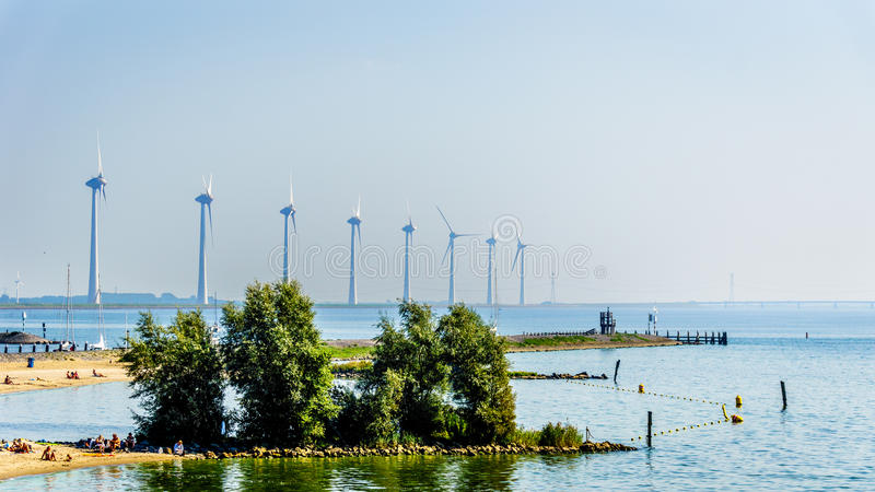 Wind Turbines, the modern Windmills by the Veluwemeer in the Netherlands stock photo