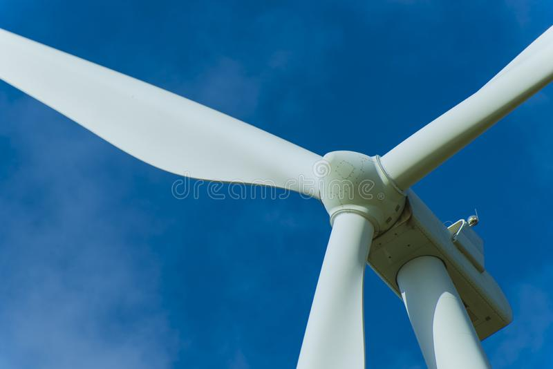 Wind turbines and the morning sky with sunlight stock images