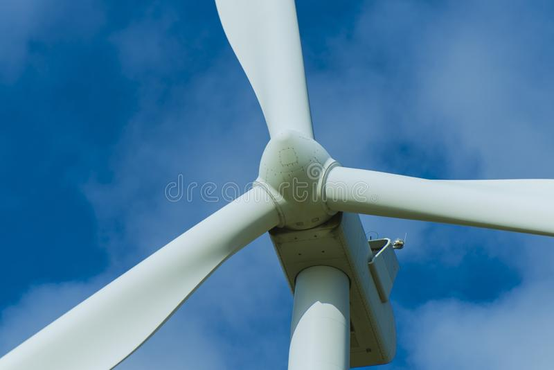 Wind turbines and the morning sky with sunlight royalty free stock photo